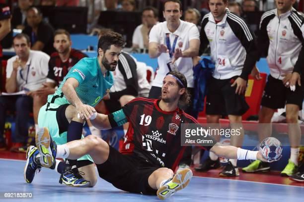 Laszlo Nagy of Veszprem is challenged by Raul Entrerrios Rodriguez of Barcelona during the VELUX EHF FINAL4 3rd place match between Telekom Veszprem...