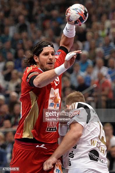 Laszlo Nagy of Veszprem throws the ball during the 'VELUX EHF FINAL4' semi final match between THW Kiel v MKBMVM Veszprem at Lanxess Arena on May 30...