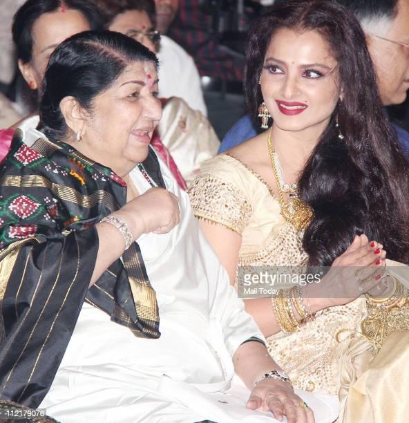 Lata Mangeshkar and Rekha during the music launch of album 'Sarhadein' by Sa Re Ga Ma and Radio City at Taj Lands End Mumbai
