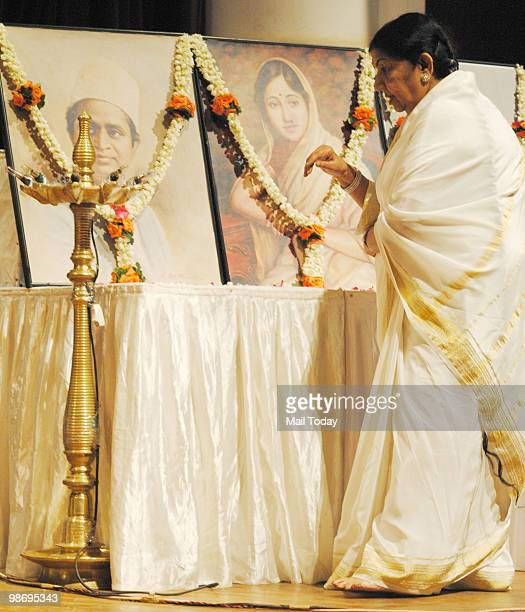 Lata Mangeshkar lights the lamp at the Deenanath Mangeshkar Awards in Mumbai on Sunday April 25 2010