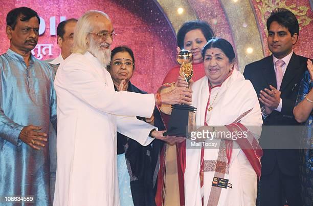 Lata Mangeshkar receiving an award from Babasaheb Purandare during the 'Salaam Maharashtra' Award set up by Marathi entertainment channel 'Mi...