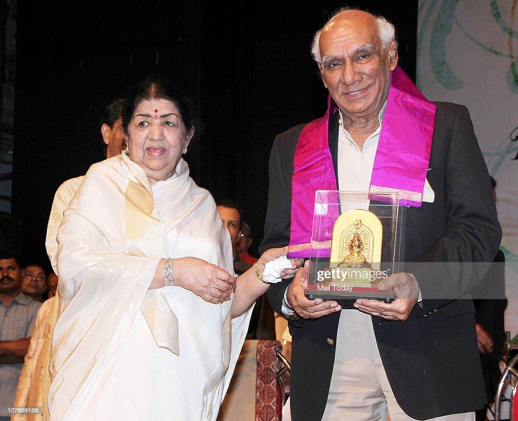 Lata Mangeshkar with Yash Chopra at her birthday concert in Mumbai on Wednesday night.