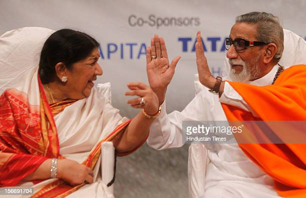 Lata Mangeskar and Balasaheb Thackeray during Master Dinanath Mangeshkar memorial award at Shanmukhananda Hall at Sion on April 24 2012 in Mumbai...
