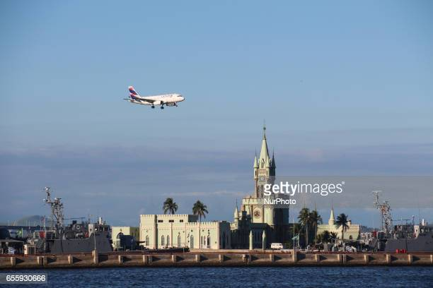 Latam airplane overflys Fiscal Island a historical building from the period of the Portuguese Empire in Brazil This building was inaugurated in April...