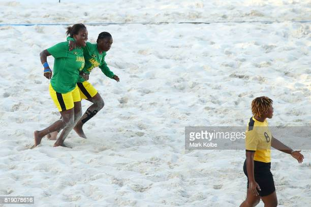 LaTavia Russell and Tiana Schroeter of Jamaica celebrate scoring a try during the Girls Beach Soccer match 3 between the Bahamas and Jamaica on day 2...