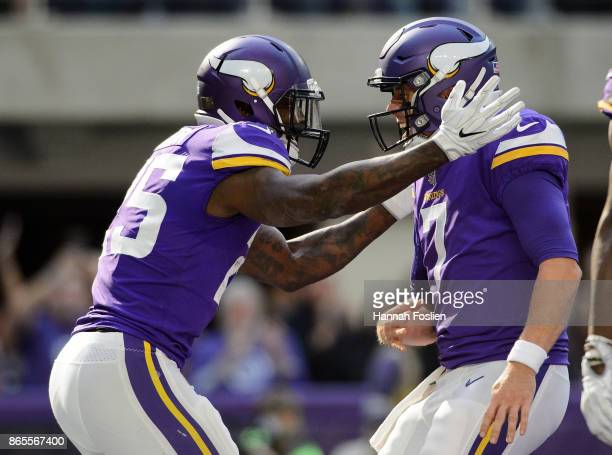 Latavius Murray and Case Keenum of the Minnesota Vikings celebrate a touchdown against the Baltimore Ravens during the game on October 22 2017 at US...