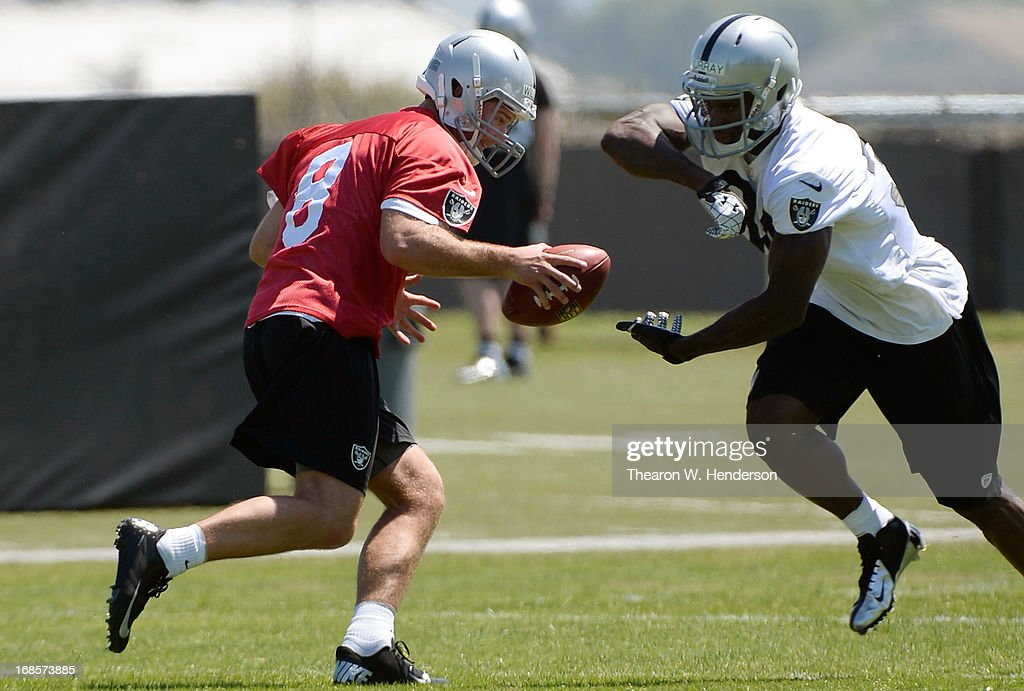 Latavius Murray #34 and Tyler Wilson #8 of the Oakland Raiders participates in drills during Rookie Mini-Camp on May 11, 2013 in Alameda, California.