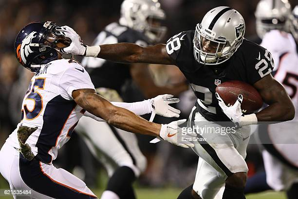 Latavius Murray of the Oakland Raiders carries the ball during the second quarter against the Denver Broncos at OaklandAlameda County Coliseum on...