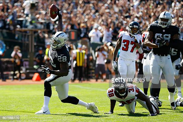 Latavius Murray of the Oakland Raiders celebrates after a 1yard touchdown run during their NFL game against the Atlanta Falcons at OaklandAlameda...