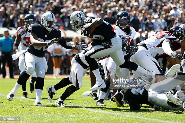 Latavius Murray of the Oakland Raiders scores a 1yard touchdown during their NFL game against the Atlanta Falcons at OaklandAlameda County Coliseum...