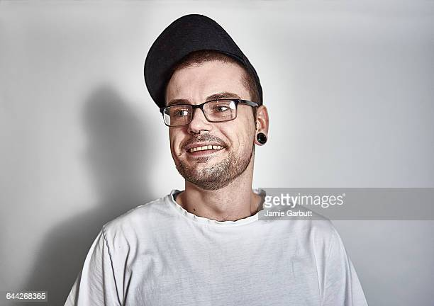 Late 20's British male smiling looking to the side