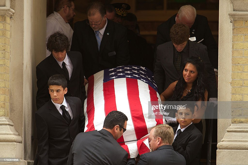Late actor Dennis Farina's grandchildren serve as pallbearers during his Funeral Service at Assumption Catholic Church on July 30, 2013 in Chicago, Illinois.