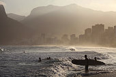 A late afternoon beach scene at Arpoador Beach with Ipanema and Leblon in the distance Rio de Janeiro Brazil August 8 2010 Photo by Lisa Wiltse