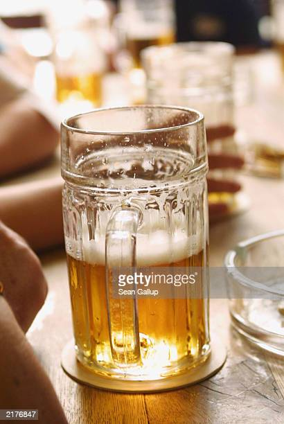 Late afternoon light shines through a halfempty glass of Pilsner Urquell beer at U Zlateho Tygra pub June 17 2003 in Prague Czech Republic U Zlateho...