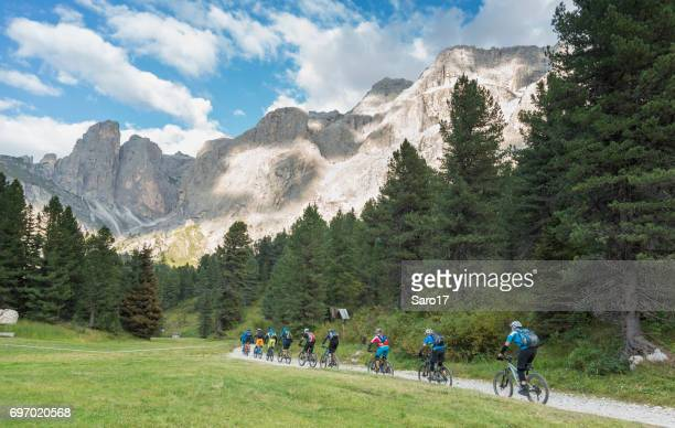 Late afternoon mountainbiking in Dolomite valley, Italy