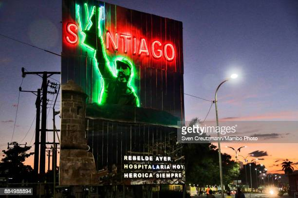 Late Cuban Revolution leader Fidel Castro is depicted on a neon sign at the Revolution square as Cuba commemorates the first anniversary of Castro's...