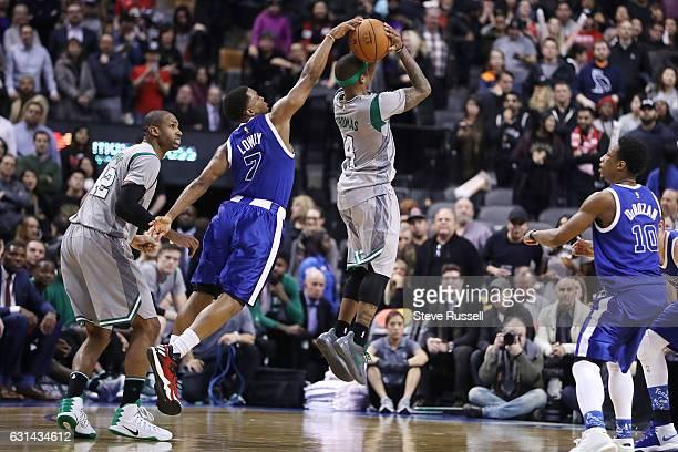 TORONTO ON JANUARY 10 Late in the game Toronto Raptors guard Kyle Lowry blocks Boston Celtics guard Isaiah Thomas as the Toronto Raptors wearing...
