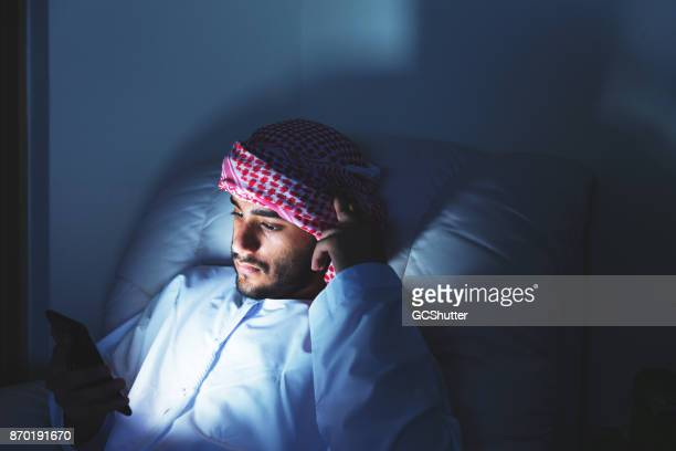 Late night reading on a couch in the middle east