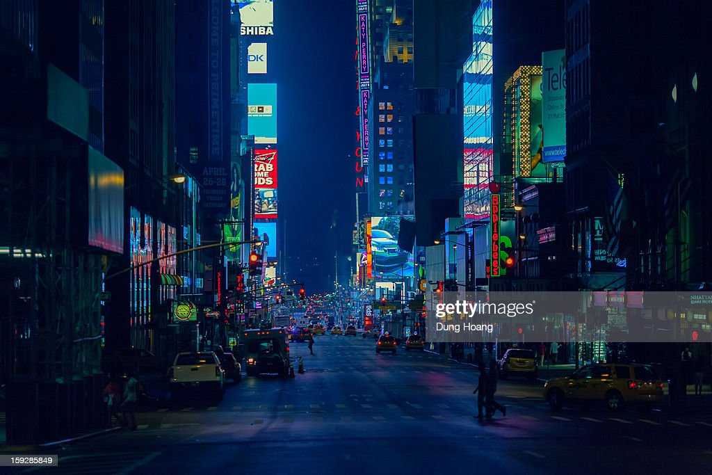 CONTENT] Late night street scene of Times Square, Manhattan, New York City in blue light from 7th Avenue