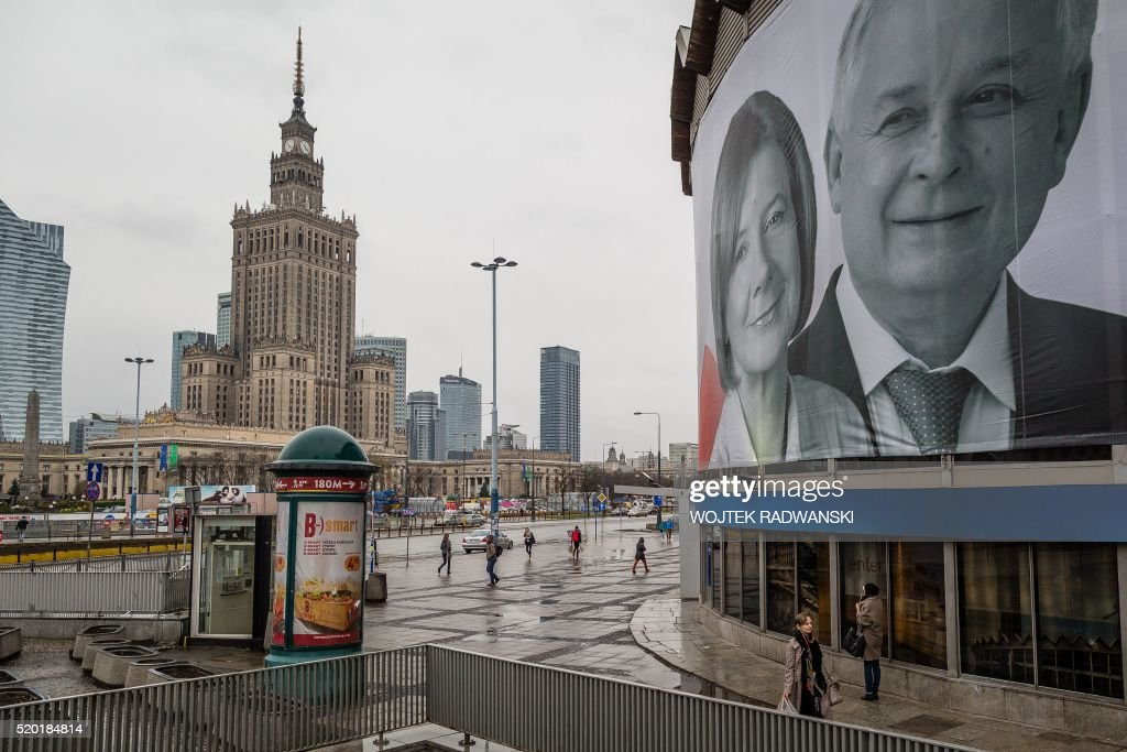 Late Polish President Lech Kaczynski and his wife Maria are seen on a giant banner in the center of Warsaw Poland marking the sixth anniversary of...