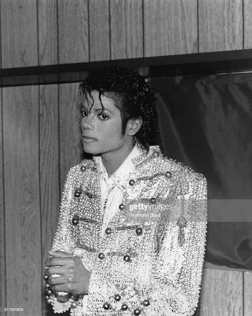 Late singer Michael Jackson from The Jacksons poses for photos backstage in his trailer prior to going on stage during The Jacksons 'Victory Tour' at...