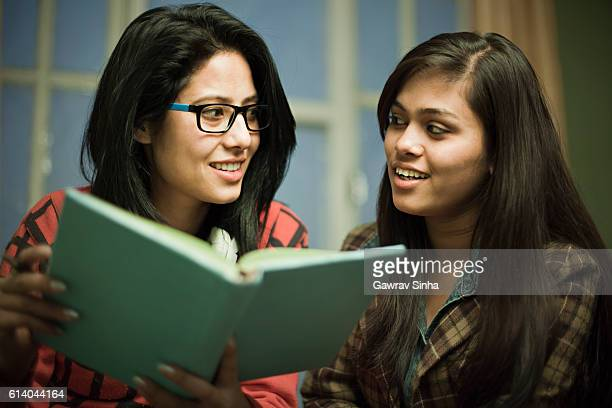 Late teen happy girl students studying together.