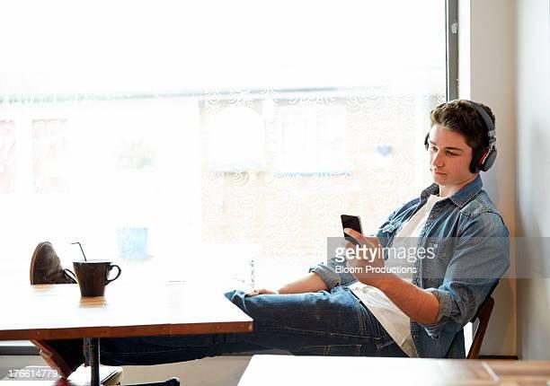 Late teens boy using technology