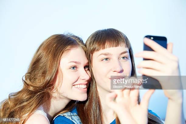 Late teens friends taking a selfie photograph