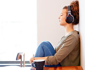 Late teens girl listening to headphones