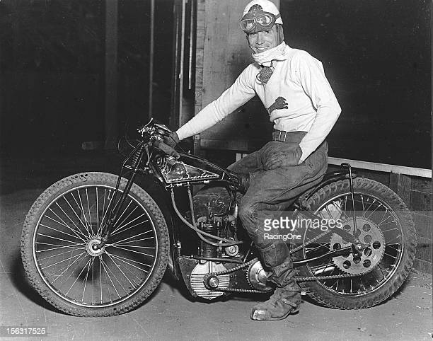 "A rider prepares for a late1920s motorcycle race on a dirt track The tires on these racing bikes were known as ""knobbies"" whose versatility on many..."