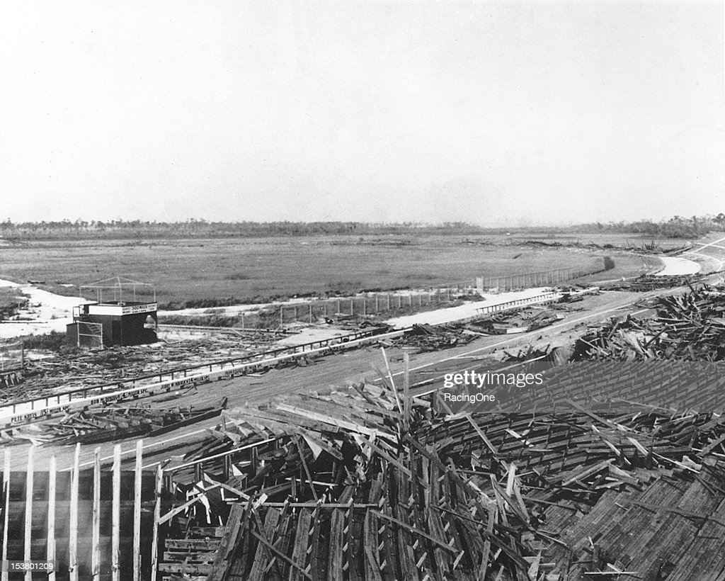 The remains of Fulford-Miami Speedway after it was destroyed by a Category 4 hurricane on September 17, 1926. The track was a 1.25-mile banked board track built by Carl F. Fisher, who had previously built the Indianapolis (IN) Motor Speedway. The track was designed by 1911 Indy 500 winner Ray Harroun. The only race at the track was held on February 22, 1926, and was won by Peter DePaolo in the same Duesenburg that he had driven to victory in the 1925 Indianapolis 500. Note that the car and driver names from that lone race can still be seen painted along the inside front stretch wall. Much of the lumber from the speedway was later used to help rebuild the City of Miami.