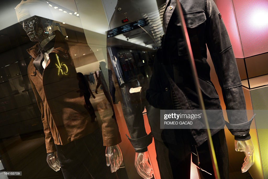 Latest men's wear are displayed at a high end fashion shop Giorgio Armani and Calvin Klein at an upscale mall in the capital city of Jakarta on March 20, 2013.