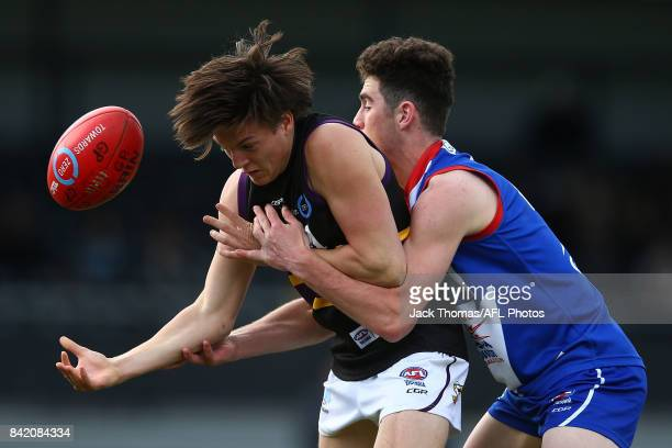 Latham Vandeermeer of the Murray Bushrangers is tackled during the TAC Cup round 18 match between Gippsland and Murray at Victoria Park on September...