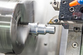 CNC lathe machine (Turning machine) while cutting the aluminium screw thread.Hi-precision CNC machining concept.
