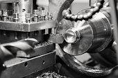 CNC lathe processes metal part. Automated production.