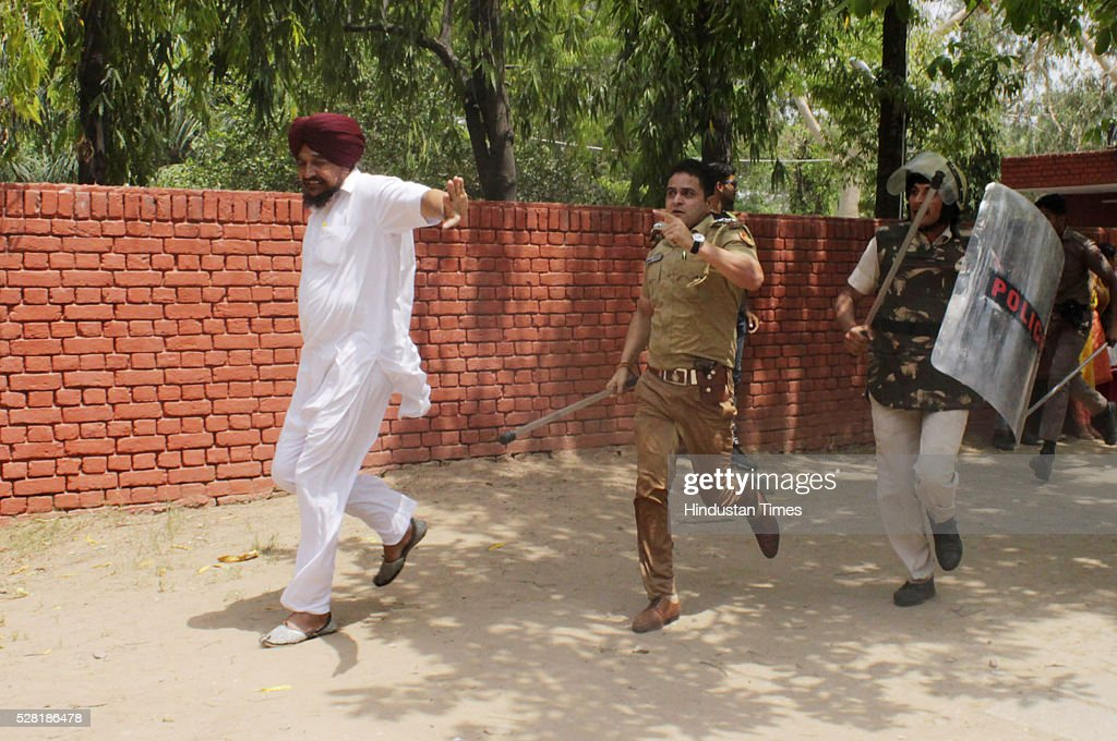 Lathi charge by Chandigarh police on Punjab Congress workers during their protest against Punjab Chief Minister Parkash Singh Badal over non-payment to farmers for wheat procurementat sector 15 -11 dividing road on May 4, 2016 in Chandigarh, India.