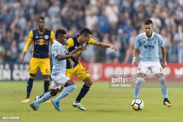 Latif Blessing of Sporting Kansas City and Sean Davis of New York Red Bulls fight for the ball in the US Open Cup Final match at Children's Mercy...