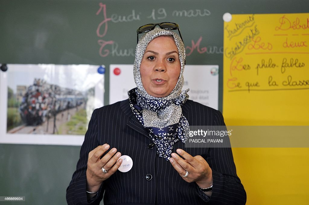 Latifa Ibn Ziaten, president of the Imad association and mother of French soldier Imad Ibn Ziaten who was killed by Islamist gunman <a gi-track='captionPersonalityLinkClicked' href=/galleries/search?phrase=Mohamed+Merah&family=editorial&specificpeople=9049166 ng-click='$event.stopPropagation()'>Mohamed Merah</a> in March 2012, speaks to school children at the Jean Dargassies elementary school in Eaunes on March 19, 2015 in a civic education class during a week of education against racism and antisemitism.