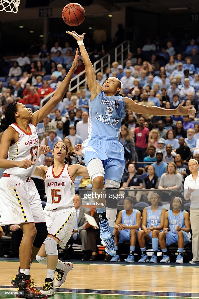 Latifah Coleman #2 of the North Carolina Tar Heels puts up a shot against Alicia DeVaughn #13 of the Maryland Terrapins during the semifinals of the 2013 Women's ACC Tournament at the Greensboro Coliseum on March 9, 2013 in Greensboro, North Carolina.