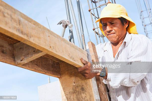 Latin American construction site with worker