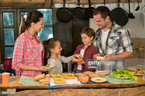 Latin American family making sandwiches in their cozy home