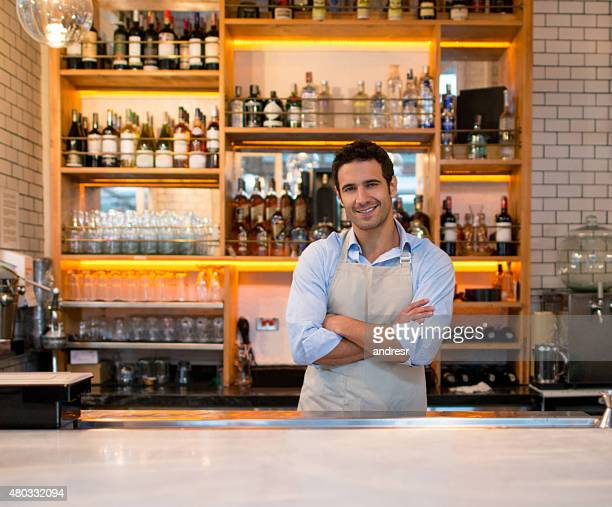 Latin American man working at a bar