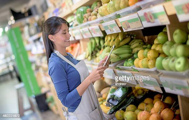 Latin American woman working at a food market