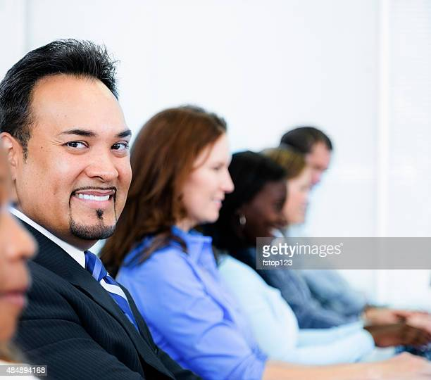 Latin business man in training class. College computer lab.