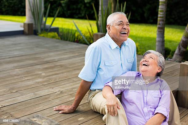 Latin couple laughing on deck