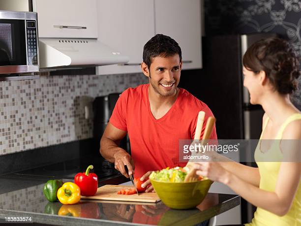 Latin couple preparing a salad together