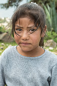 Profound glance of a very young harvesting girl