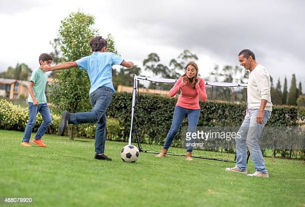 Latin family playing soccer