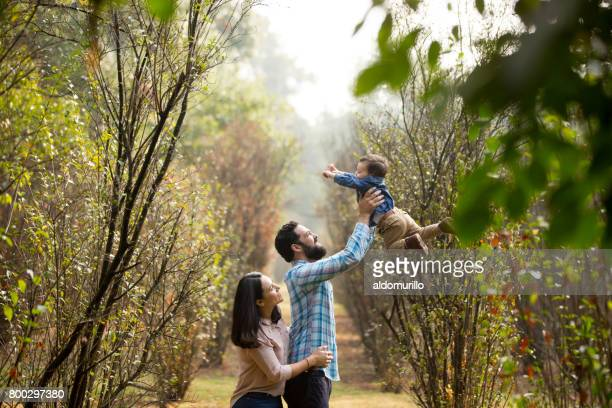 Latin family with little boy having fun