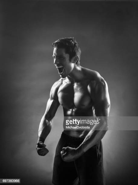 B&W Latin Fighter Posing On A Black Background